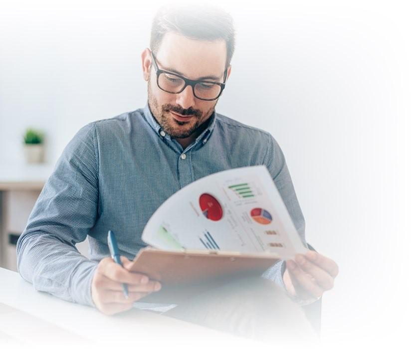 A man looking at paperwork